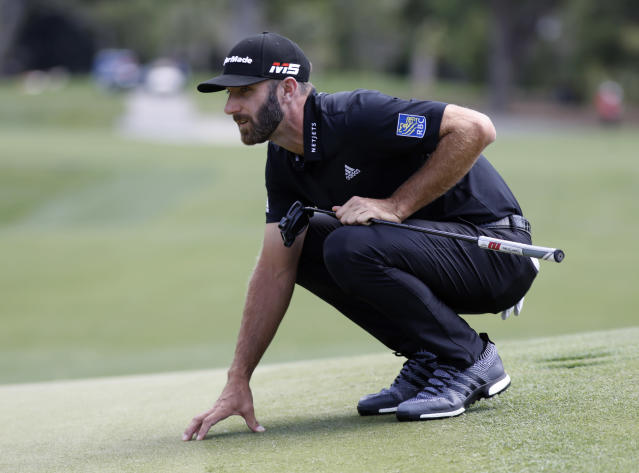 Dustin Johnson lines up a putt on the sixth green during the final round of the RBC Heritage golf tournament at Harbour Town Golf Links on Hilton Head Island, S.C., Sunday, April 21, 2019. Johnson was the third round leader but shot a six over par 77 during the final round. (AP Photo/Mic Smith)
