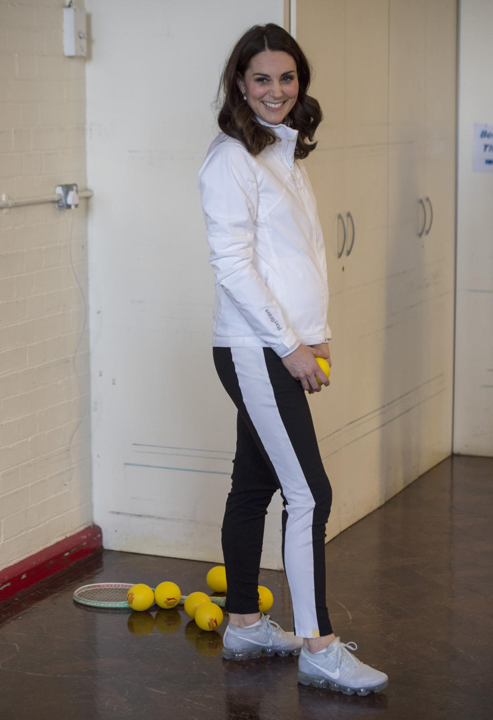 The Duchess of Cambridge showcased her blossoming baby bump in a zip-up jacket by Clarice [Photo: PA]