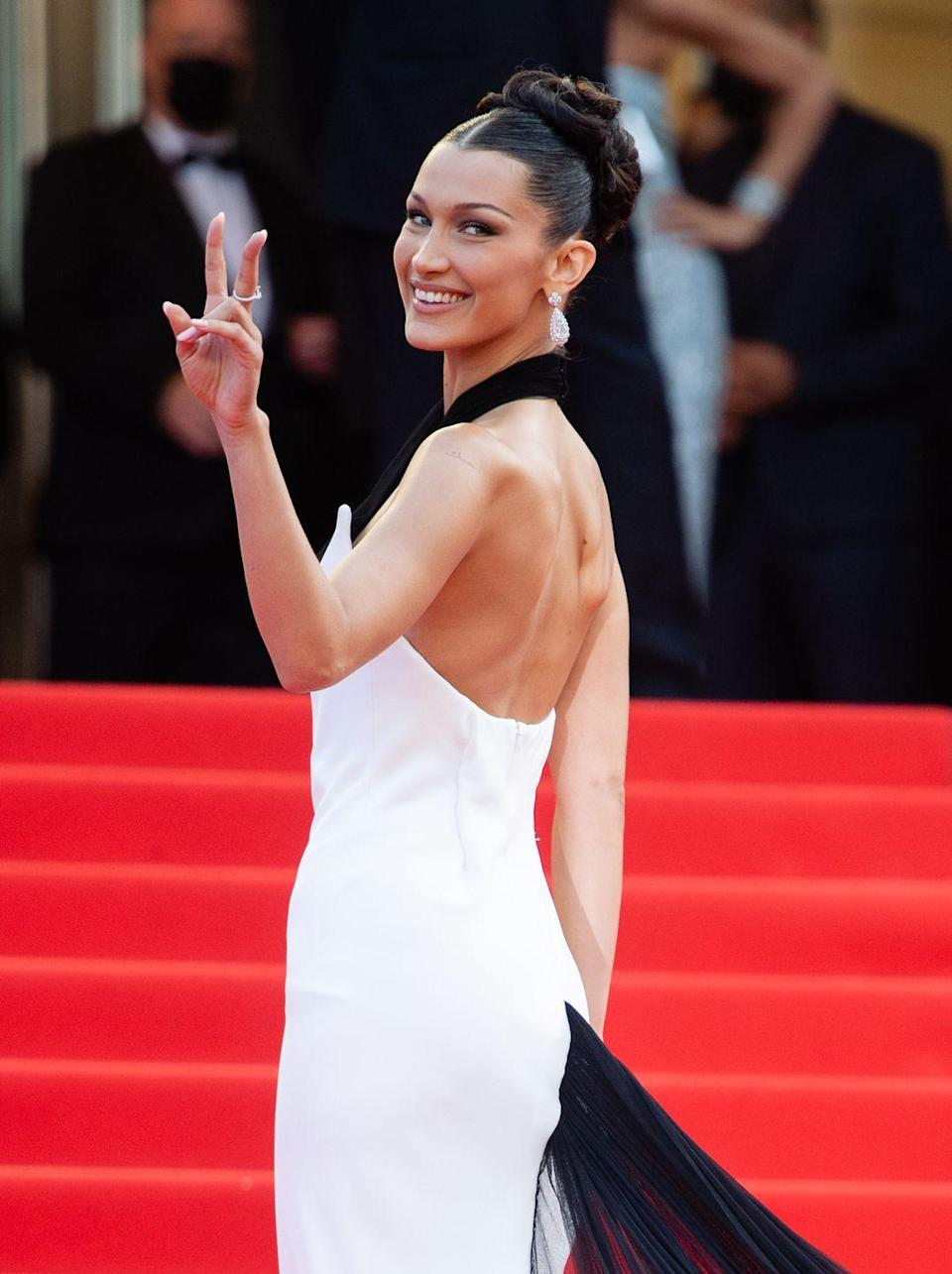 <p>Model <strong>Bella Hadid</strong>'s most recent hair color looks inky black at first glance, but in the right lighting, you can tell it's actually infused with red undertones. At a salon, ask for a red gloss on black hair to achieve this multi-tonal look.</p>