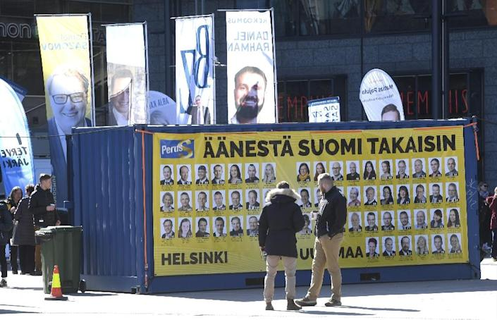 The populist Finns Party, which has capitalised on a rise in sentiment against migrants and a perception they represent a security threat, could surge in Sunday's election (AFP Photo/Heikki Saukkomaa)