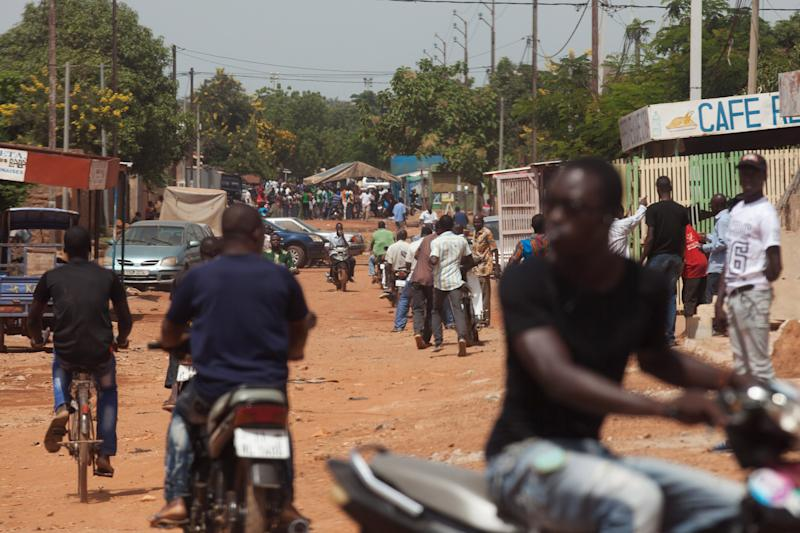 Anti-coup protesters look for members of the presidential guard in Ouagadougou