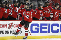 Teammates congratuate New Jersey Devils center Pavel Zacha (37), of the Czech Republic, after Zacha scored a goal during the first period of an NHL hockey gam against the Nashville Predators, Thursday, Jan. 30, 2020, in Newark, N.J. (AP Photo/Kathy Willens)