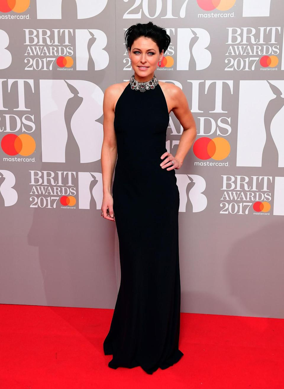 <p>The presenter went for a simple fitted gown. <i>[Photo: PA]</i> </p>