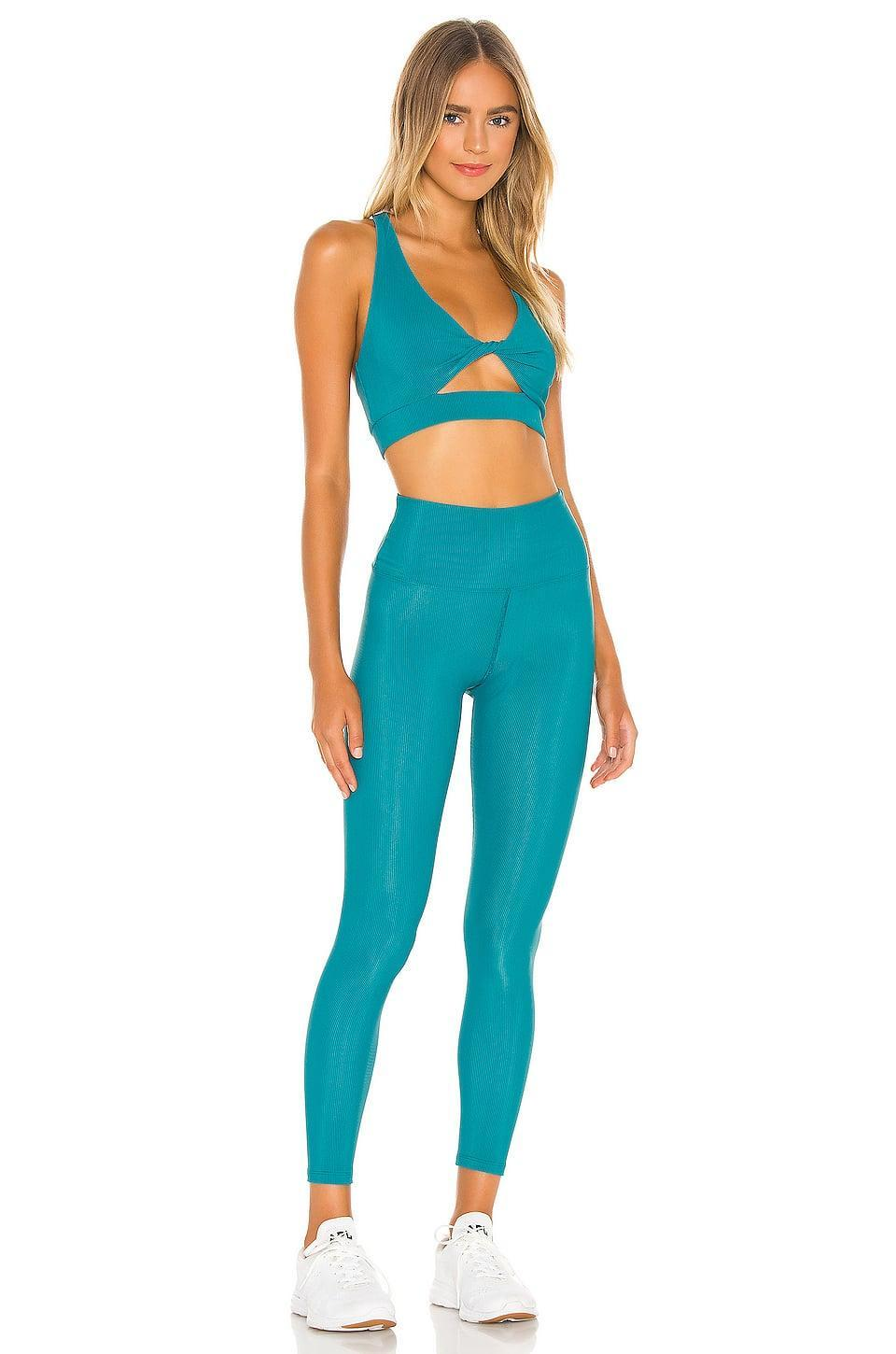 <p>We love everything about this fun <span>Beach Riot Twist Top</span> ($84) and <span>Ribbed Ayla Legging</span> ($84).</p>