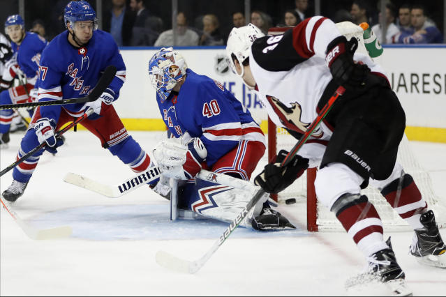 A shot by Arizona Coyotes left wing Lawson Crouse, not seen, gets past New York Rangers goaltender Alexandar Georgiev (40) as Rangers defenseman Tony DeAngelo (77) and Coyotes right wing Christian Fischer (36) watch during the first period of an NHL hockey game Tuesday, Oct. 22, 2019, in New York. (AP Photo/Kathy Willens)