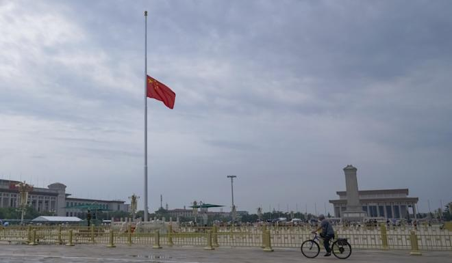 A Chinese national flag flies at half-mast in Tiananmen Square. Photo: Xinhua