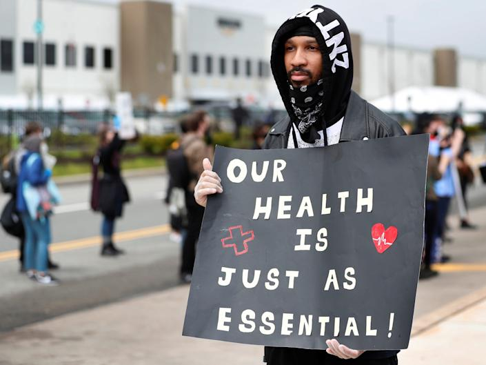 """Former Amazon employee, Christian Smalls, stands with fellow demonstrators during a protest outside of an Amazon warehouses in the Staten Island borough of New York on May 1, 2020. <p class=""""copyright"""">REUTERS/Lucas Jackson</p>"""