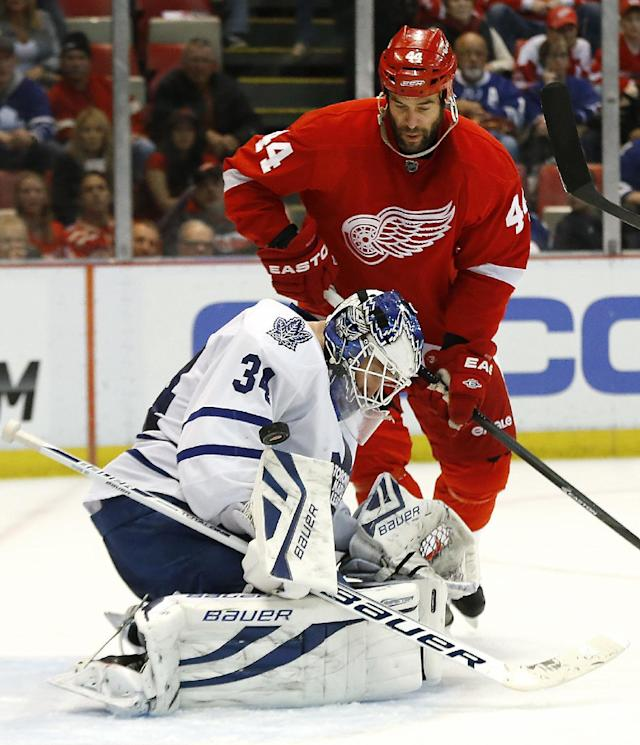 Toronto Maple Leafs goalie James Reimer (34) stops a shot as Detroit Red Wings right wing Todd Bertuzzi (44) watches for a rebound in the second period of an NHL hockey game in Detroit, Tuesday, March 18, 2014. (AP Photo/Paul Sancya)