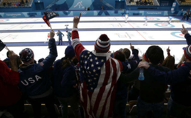 A fan wearing the American flag cheers during the men's curling semi-final match between United States and Canada at the 2018 Winter Olympics in Gangneung, South Korea, Thursday, Feb. 22, 2018. United States won. (AP Photo/Aaron Favila)