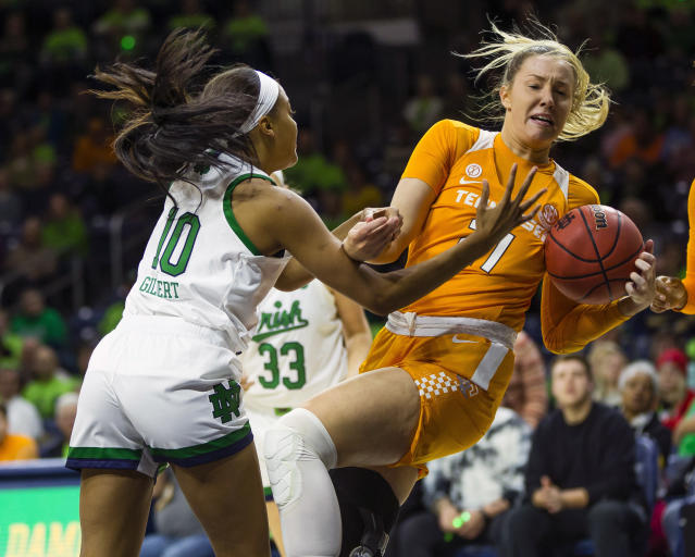 Notre Dame's Katlyn Gilbert (10) fights for a rebound with Tennessee's Lou Brown (21) during an NCAA college basketball game Monday, Nov. 11, 2019 at Purcell Pavilion in South Bend, Ind. (Michael Caterina/South Bend Tribune via AP)