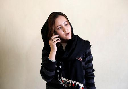 Zahra Elham, 18, an Afghan singer talks on her phone in Kabul, Afghanistan April 3, 2019. Picture taken April 3, 2019. REUTERS/Mohammad Ismail