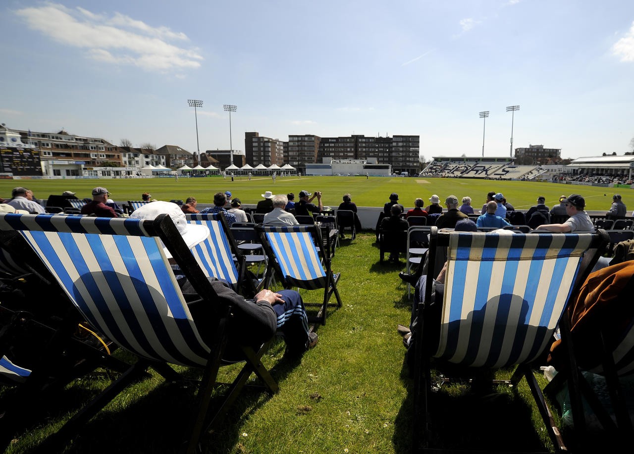HOVE, ENGLAND - MAY 01: Spectators enjoy the sun and cricket from deck chairs during day one of the LV County Championship match between Sussex and Warwickshire at The Brighton and Hove Jobs County Ground on May 01, 2013 in Hove, England. (Photo by Charlie Crowhurst/Getty Images)