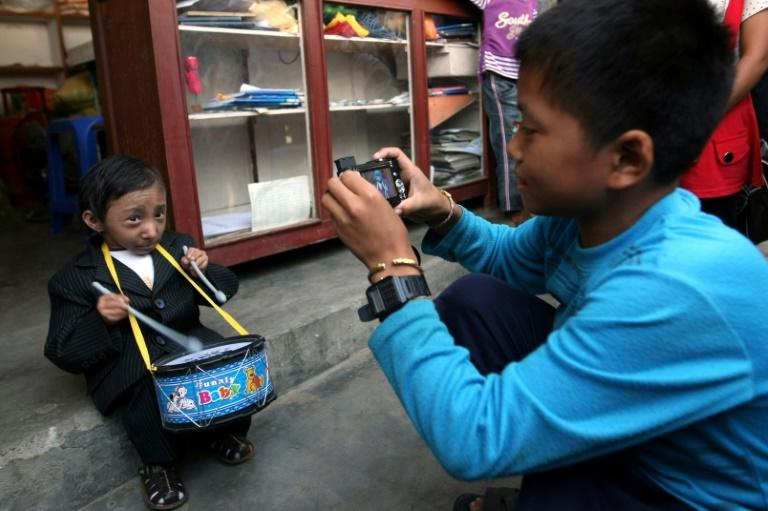 Khagendra Thapa Magar is photographed by his brother at their apartment in Pokhara in October 2010 (AFP Photo/PRAKASH MATHEMA)