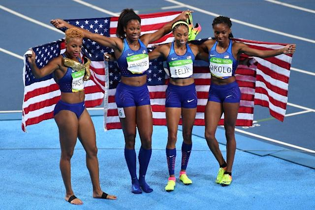 (From L) USA's Natasha Hastings, Phyllis Francis, Allyson Felix and Courtney Okolo celebrate after they won the Women's 4x400m Relay Final (AFP Photo/Pedro Ugarte)