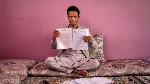 PHOTO: Afghan former interpreter for US forces, Abdul Rashid Shirzad poses for a photograph as he is showing his documents during an interview with EFE at his house in Kabul, Afghanistan, June 22, 2021. (Hedayatullah Amid/EPA via Shutterstock)