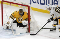 Pittsburgh Penguins' Sidney Crosby can't get the puck past Boston Bruins goaltender Jaroslav Halak during the second period of an NHL hockey game Saturday, April 3, 2021, in Boston. (AP Photo/Winslow Townson)