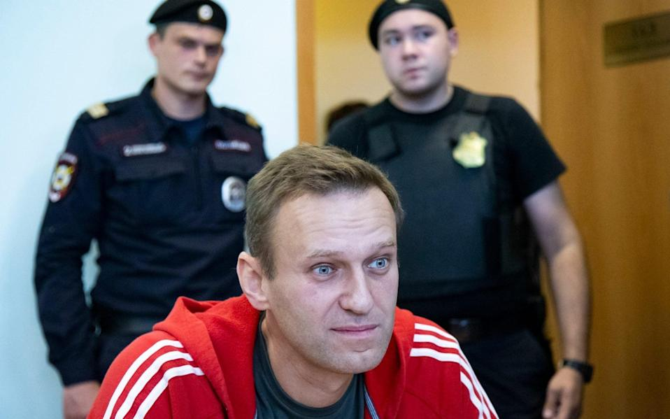 Alexei Navalny is suing the Kremlin spokesman for his claims that he has been working for CIA agents - Alexander Zemlianichenko/AP
