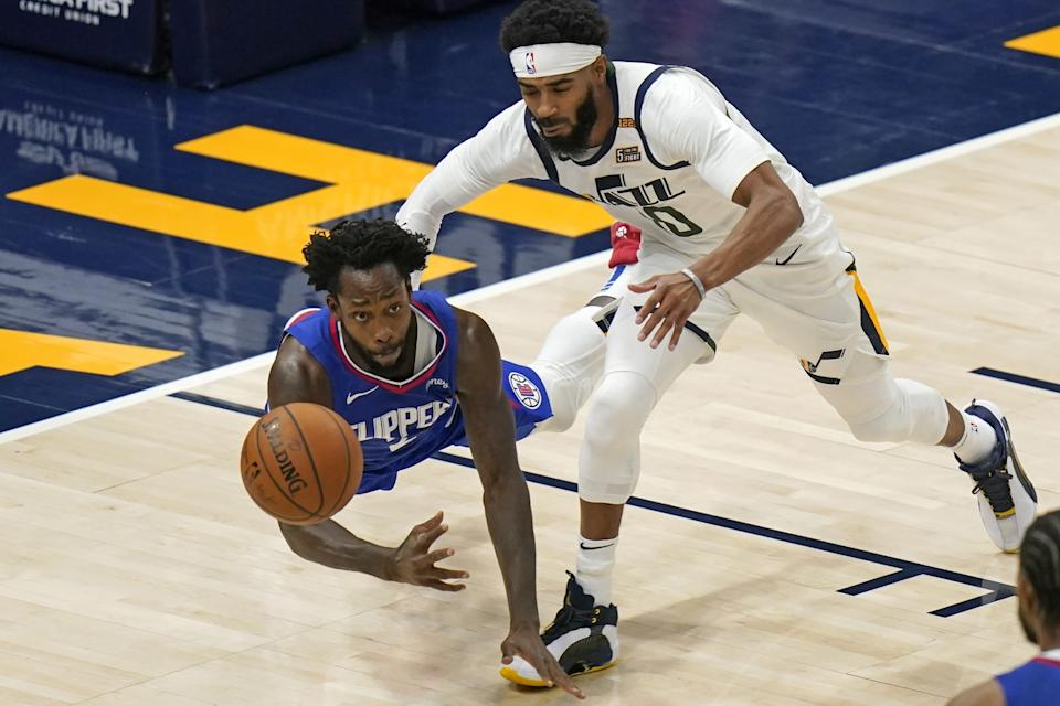 Clippers guard Patrick Beverley and Utah Jazz guard Mike Conley scramble for a loose ball.