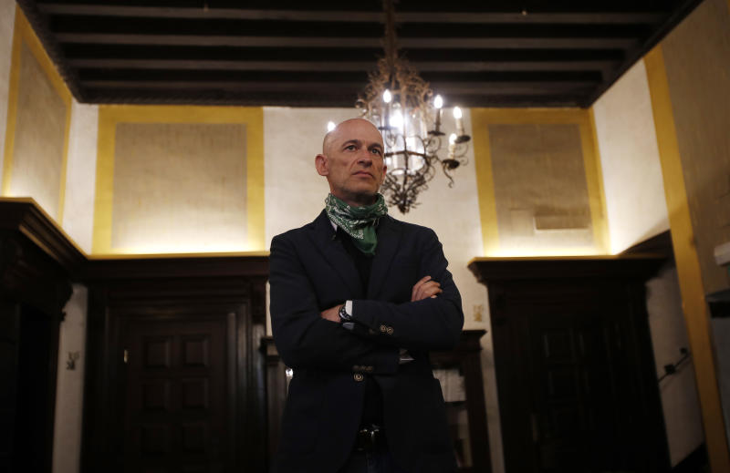 In this picture taken on Wednesday, May 13, 2020, owner of Saturnia hotel Gianni Serandrei stands as he waits for an Associated Press interview in Venice, Italy. Venetians are rethinking their city in the quiet brought by the coronavirus pandemic. For years, the unbridled success of Venice's tourism industry threatened to ruin the things that made it an attractive destination to begin with. Now the pandemic has ground to a halt Italy's most-visited city, stopped the flow of 3 billion euros in annual tourism-related revenue and devastated the city's economy. (AP Photo/Antonio Calanni)