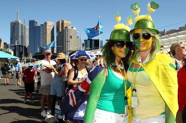 MELBOURNE, AUSTRALIA - JANUARY 16: Australian tennis fans arrive for day one of the 2012 Australian Open at Melbourne Park on January 16, 2012 in Melbourne, Australia. (Photo by Scott Barbour/Getty Images)