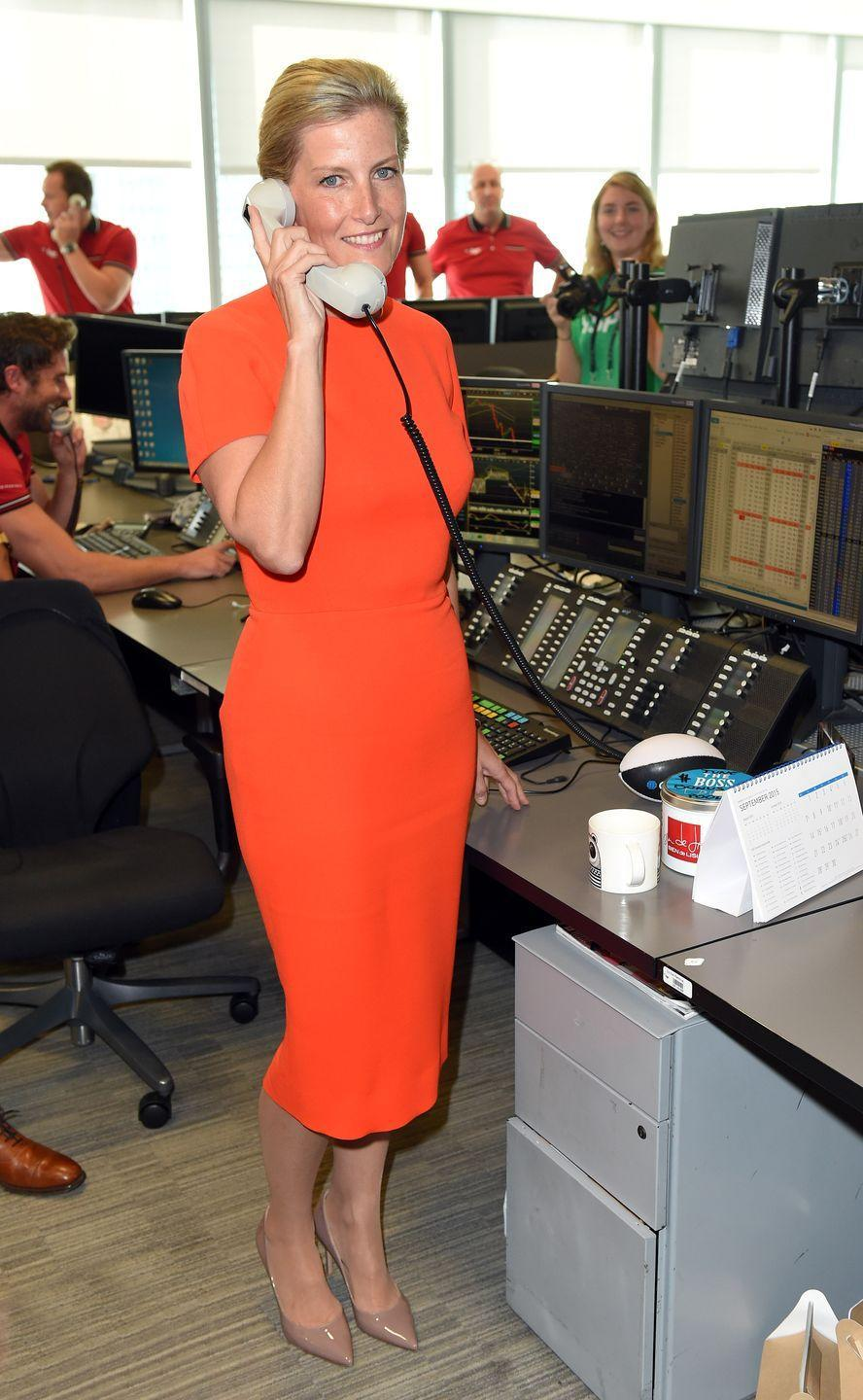 <p>Sophie chose a bright red dress to answer phones for charity in 2015.</p>