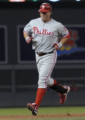 Philadelphia Phillies' Jim Thome rounds the bases after his three-run home run off Minnesota Twins starting pitcher Scott Diamond in the third inning of a baseball game Thursday, June 14, 2012, in Minneapolis. (AP Photo/Jim Mone)