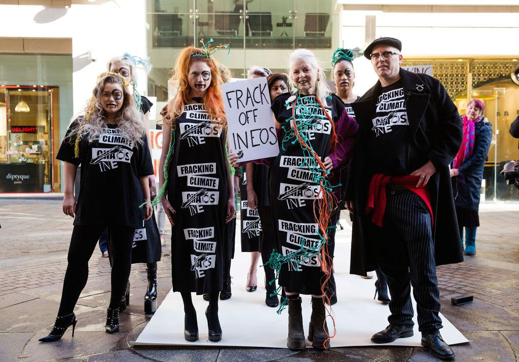 "<p>Westwood with a group of models and activists carrying a ""Frack off Ineos"" sign outside the Ineos headquarters. (Photo: Getty) </p>"