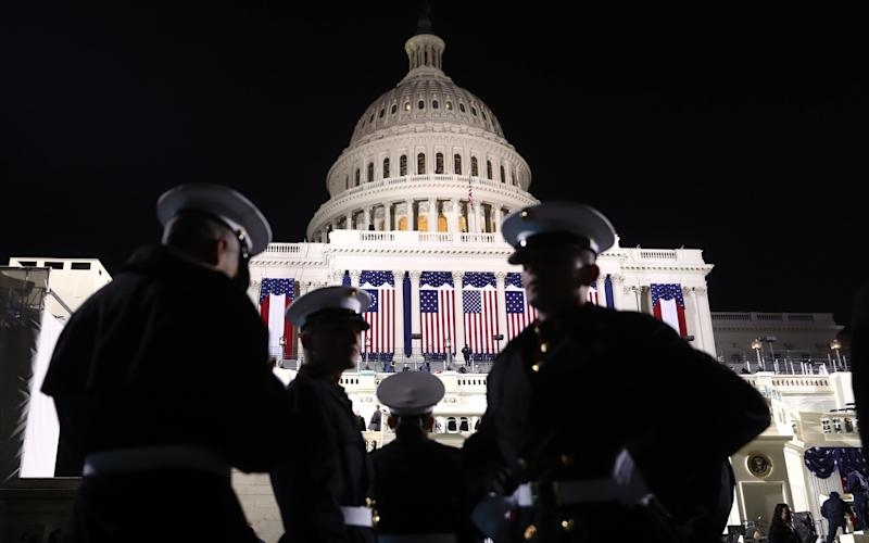 Marines stand in front of the U.S. Capitol building