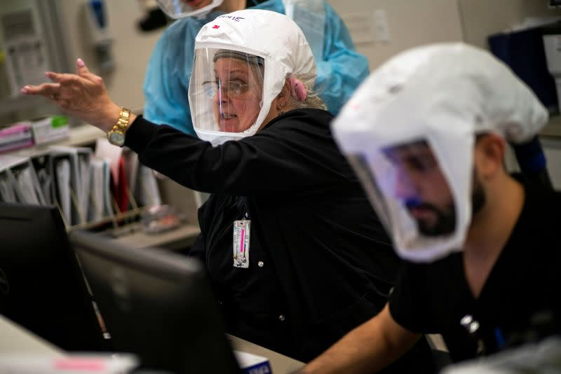 Healthcare personnel work inside a COVID-19 unit at Trinitas Regional Medical Center in Elizabeth, New Jersey