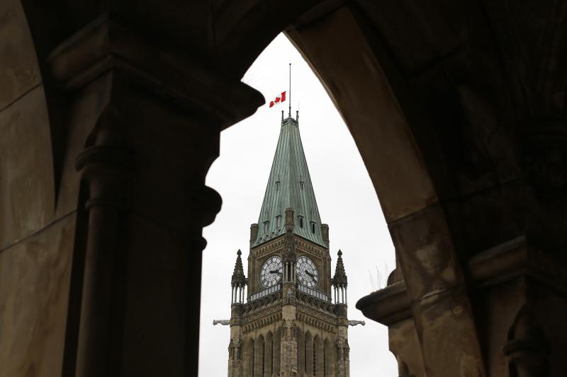 The Canadian flag flies at half-mast on the Peace Tower on Parliament Hill in Ottawa