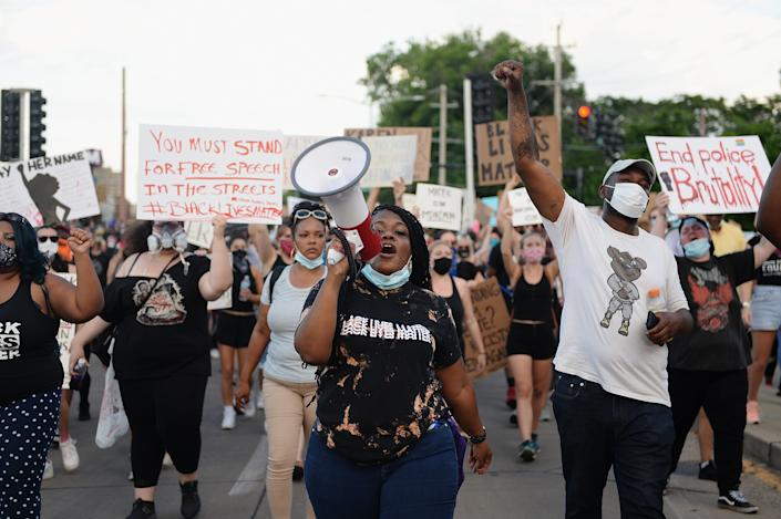 Cori Bush leads protesters as they take to the street to protest against police brutality. (Photo by Michael B. Thomas/Getty Images)