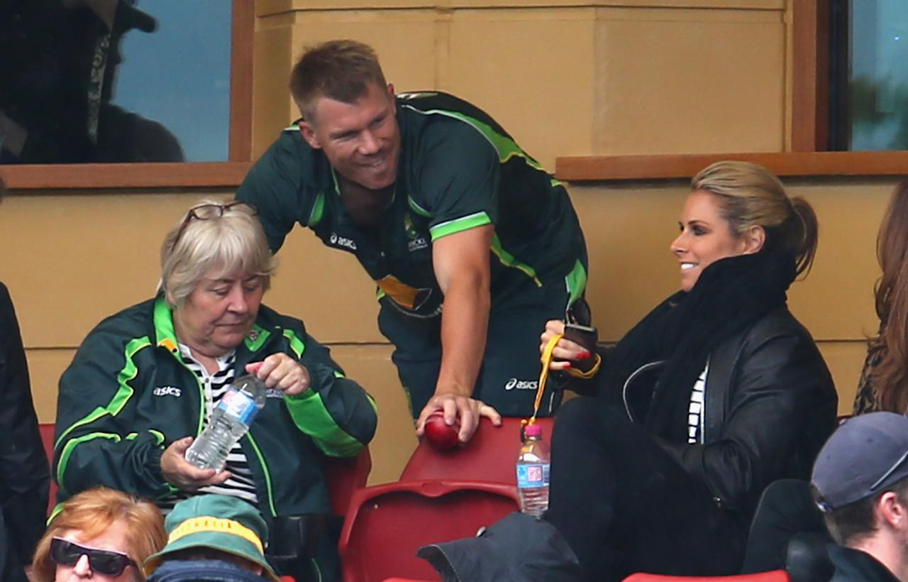 ADELAIDE, AUSTRALIA - DECEMBER 05:  David Warner of Australia speaks to his partner Candice Falzon during day one of the Second Ashes Test Match between Australia and England at Adelaide Oval on December 5, 2013 in Adelaide, Australia.  (Photo by Ryan Pierse/Getty Images)
