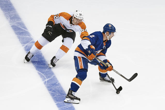 New York Islanders' Nick Leddy, right, vies for the puck with Philadelphia Flyers' Nicolas Aube-Kubel, left, during the third period of a preseason NHL hockey game in New York, Sunday, Sept. 16, 2018. (AP Photo/Andres Kudacki)