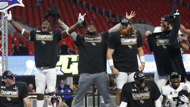 Central Florida players celebrate after the Peach Bowl NCAA college football game against Auburn, Monday, Jan. 1, 2018, in Atlanta. Central Florida won 34-27. (AP Photo/John Bazemore)