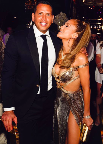 To ring in her 50th birthday, J Lo chose a bespoke Versace cut-away dress with bondage-style detailing and a serious thigh-split hem. Yes, it's just another look to add to the singer's out-there closet which has been gracing the headlines since the late '90s. <em>[Photo: Instragram]</em>