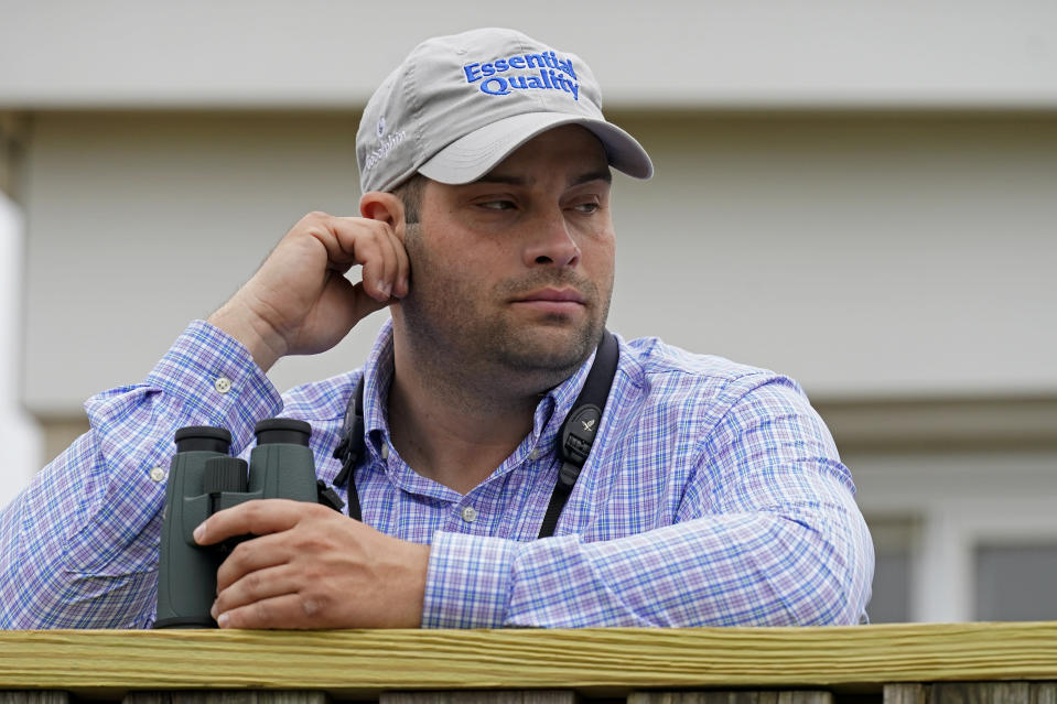 Brad Cox, trainer for Kentucky Derby entrant Essential Quality, watches a workout at Churchill Downs Thursday, April 29, 2021, in Louisville, Ky. The 147th running of the Kentucky Derby is scheduled for Saturday, May 1. (AP Photo/Charlie Riedel)