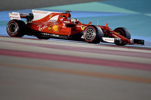 Ferrari's German driver Sebastian Vettel drives during a practice session ahead of the Formula One Bahrain Grand Prix at the Sakhir circuit in the desert south of the Bahraini capital, Manama, on April 14, 2017. (AFP Photo/ANDREJ ISAKOVIC)