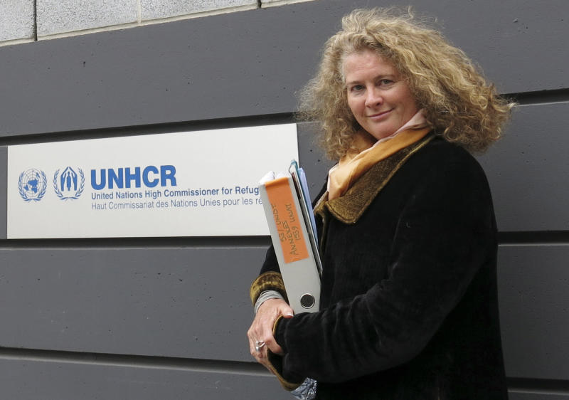 Former U.N. refugee agency investigator Caroline Hunt-Matthes poses Wednesday, May 29, 2013, in front of her former employer's headquarters in Geneva. A U.N. judge ruled in favor of her long-running complaint against the U.N. in which she said she was retaliated against for documenting a rape case in Sri Lanka a decade ago. The ruling, highly critical of the U.N.'s accountability system, awards Hunt-Matthes a year of salary and benefits plus $58,000 for her damages and suffering.  (AP Photo/John Heilprin)