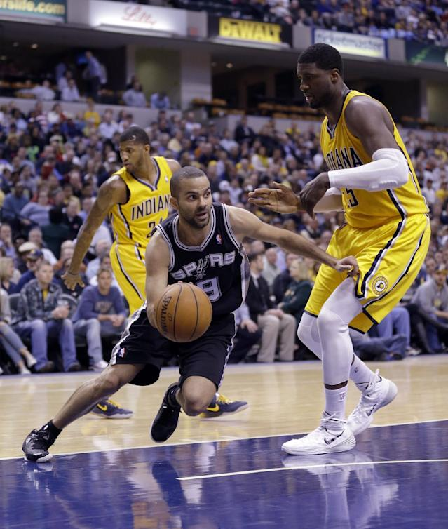San Antonio Spurs guard Tony Parker, left, drives around Indiana Pacers center Roy Hibbert in the second half of an NBA basketball game in Indianapolis, Monday, March 31, 2014. The Spurs defeated the Pacers 103-77. (AP Photo/Michael Conroy)