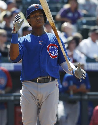 Chicago Cubs' Starlin Castro reacts after lining out with two runners on-base against the Colorado Rockies to end the top of the fifth inning of a baseball game in Denver, Sunday, July 21, 2013. (AP Photo/David Zalubowski)