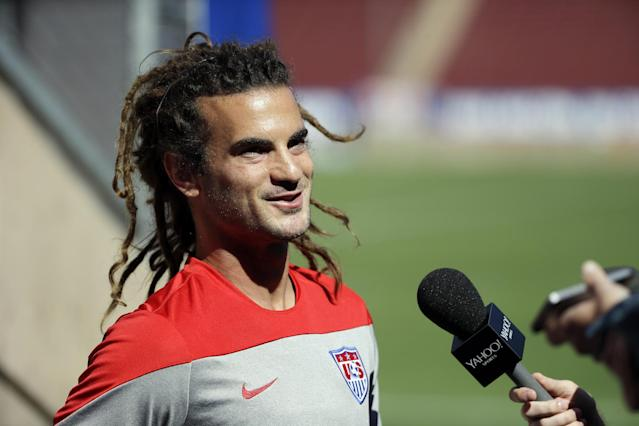 Kyle Beckerman answers questions during training in preparation for the World Cup soccer tournament on Wednesday, May 21, 2014, in Stanford, Calif. (AP Photo/Marcio Jose Sanchez)