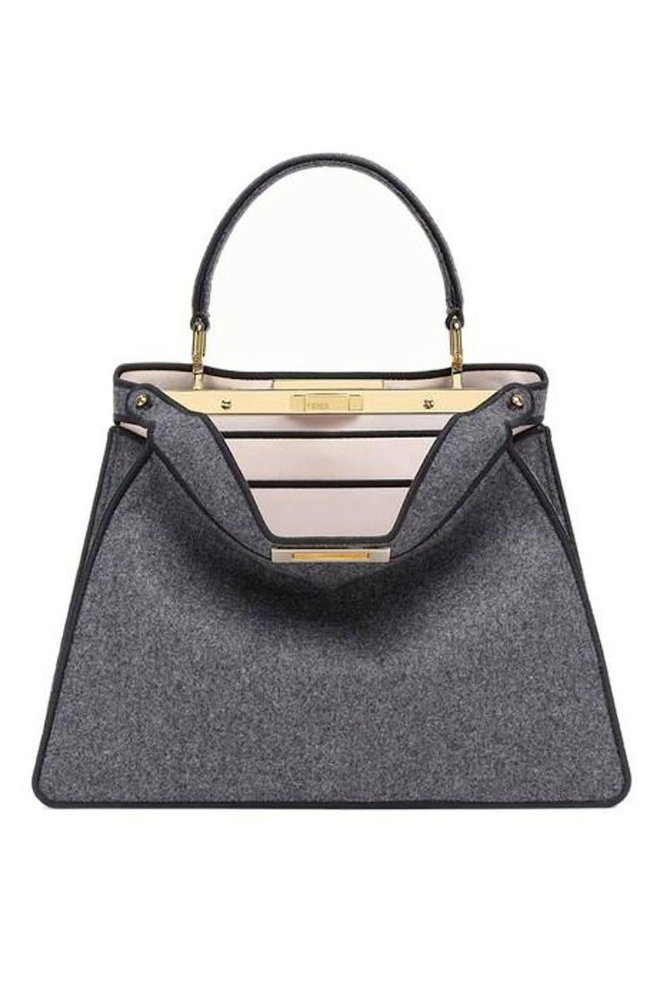 """<p><strong>Fendi</strong></p><p>fendi.com</p><p><strong>$4550.00</strong></p><p><a href=""""https://go.redirectingat.com?id=74968X1596630&url=https%3A%2F%2Fwww.fendi.com%2Fus%2Fwoman-bags%2Fmedium-peekaboo-iseeu-8bn321ae94f1d50%3Ffrom%3Dsearch%26queryId%3D52c4192863e397e6881446a91428689c&sref=https%3A%2F%2Fwww.elle.com%2Ffashion%2Fshopping%2Fg34551759%2Ffall-investment-bags-2020%2F"""" rel=""""nofollow noopener"""" target=""""_blank"""" data-ylk=""""slk:Shop Now"""" class=""""link rapid-noclick-resp"""">Shop Now</a></p><p>This playful tote by Fendi will put a smile on your face. It's a spin on a classic structured bag, with a slouchy front that drops down to reveal a satin lining in carnation pink. </p>"""