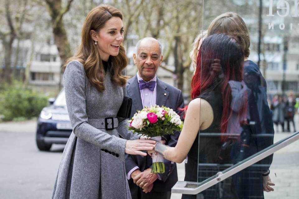 Kate receives flowers as she arrives at the Foundling Museum in London [Photo: Getty]