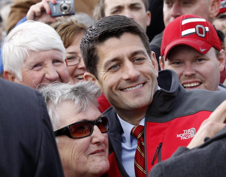 Republican vice presidential candidate, Rep. Paul Ryan, R-Wis. poses with supporters after speaking at a campaign rally at the Valley View Campgrounds in Belmont, Ohio, Saturday, Oct. 20, 2012, where he talked about economic conditions and the coal industry. (AP Photo/Keith Srakocic)