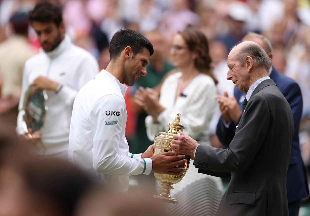 LONDON, ENGLAND - JULY 11: Novak Djokovic of Serbia is presented with the trophy by Prince Edward, Duke of Kent after winning his men's Singles Final match against Matteo Berrettini of Italy on Day Thirteen of The Championships - Wimbledon 2021 at All England Lawn Tennis and Croquet Club on July 11, 2021 in London, England. (Photo by Steven Paston - Pool/Getty Images)