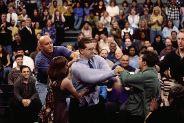 Security guard Steve Wilkos restrains a guest during a fight on <em>The Jerry Springer Show</em>. (Photo: Getty Images)