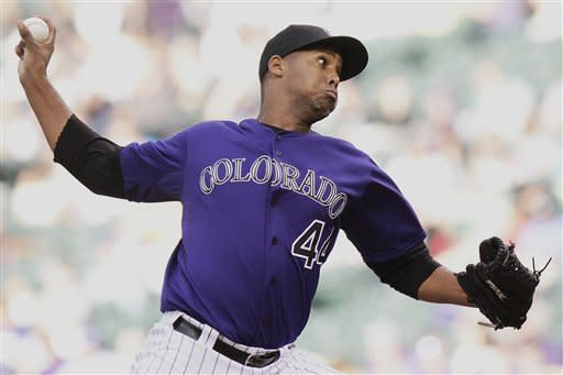 Colorado Rockies starting pitcher Juan Nicasio strikes out Los Angeles Dodgers shortstop Dee Gordon during the first inning of a baseball game Monday, April 30, 2012 in Denver, Colo. (AP Photo/Barry Gutierrez)