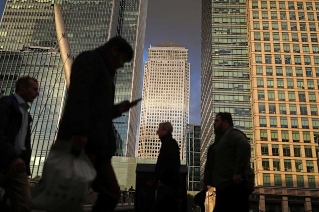 People walk through the Canary Wharf financial district of London. Photo: Simon Dawson/Reuters