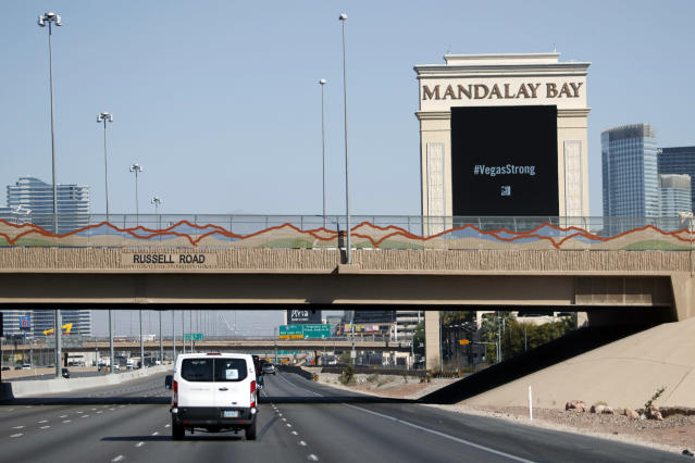 <p>President Donald Trump's motorcade passes the Mandalay Bay Resort and Casino on the way to meet with victims and first responders of the mass shooting, Wednesday, Oct. 4, 2017, in Las Vegas. (Photo: Evan Vucci/AP) </p>