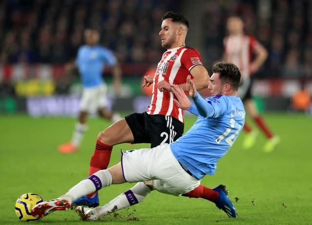 Aymeric Laporte returned for City in midweek (Mike Egerton/PA)